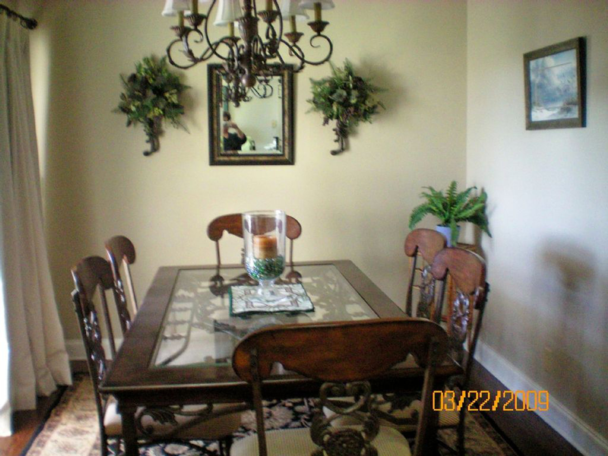 Before photos of dining room from real estate website bad lighting