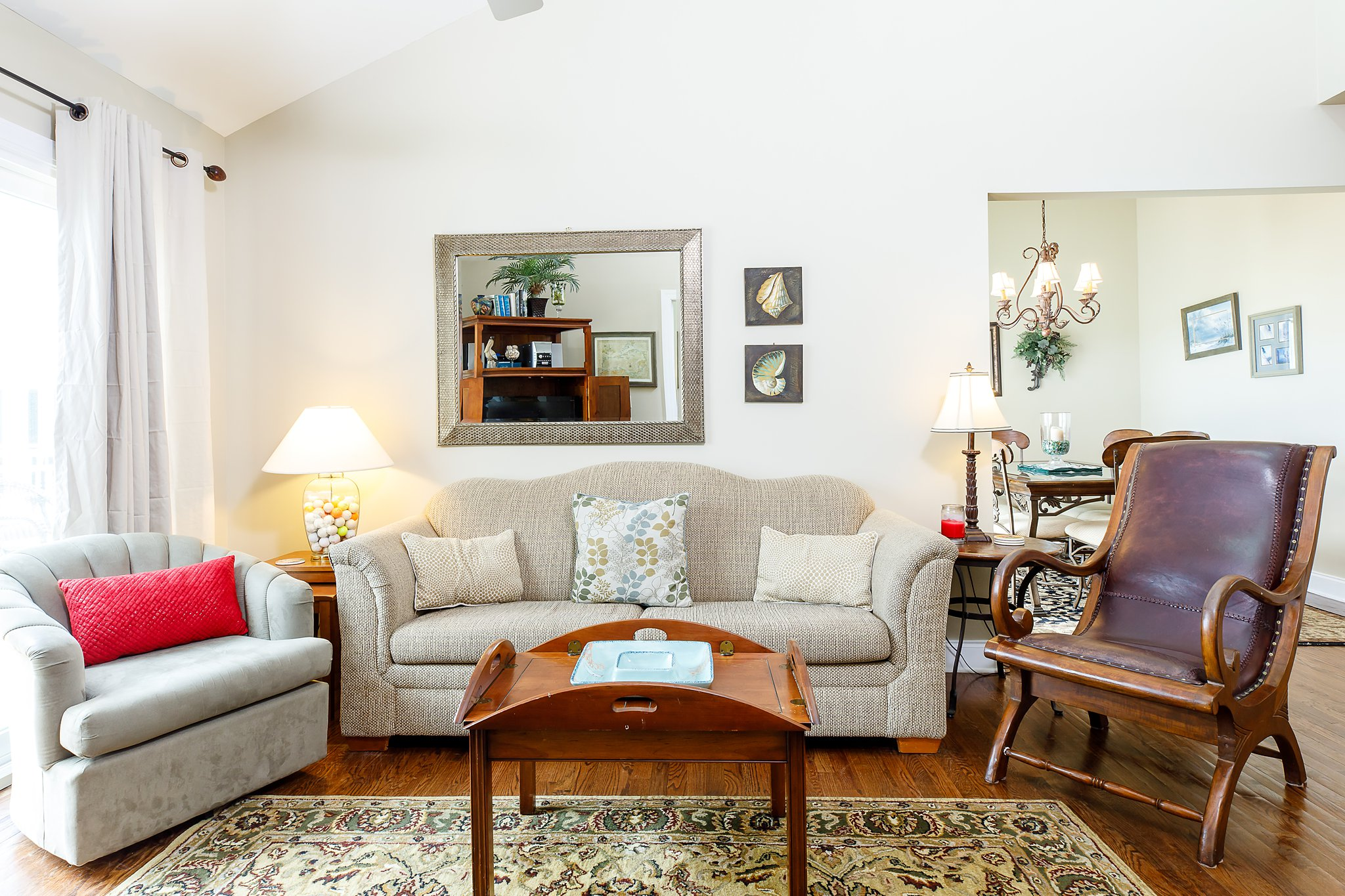 Updated photos of living room with better real estate photography for rentals