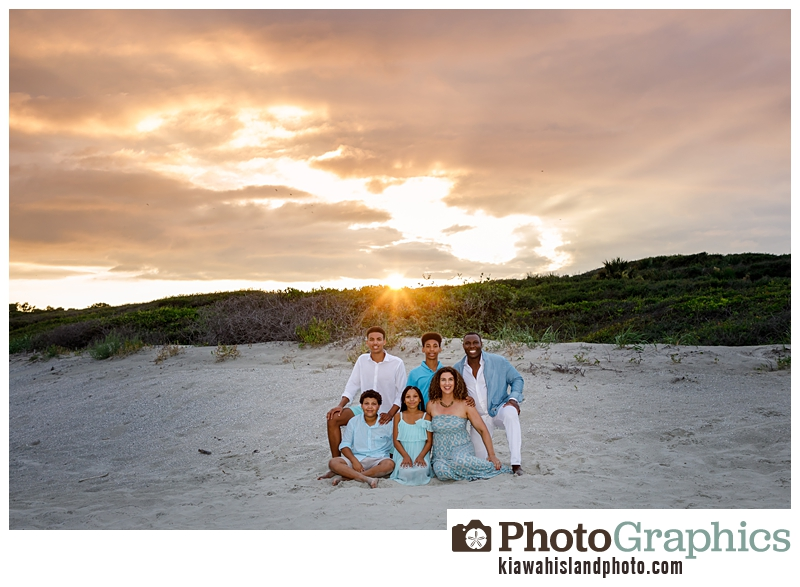 family of six on the beach at sunset on Kiawah Island in South Carolina