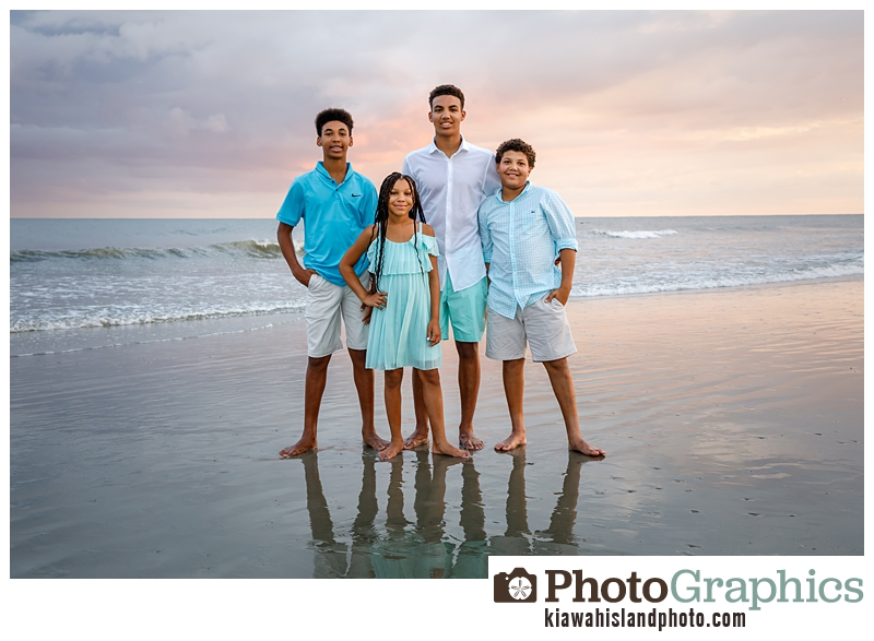 four kids on the beach at sunset during golden hour on kiawah island