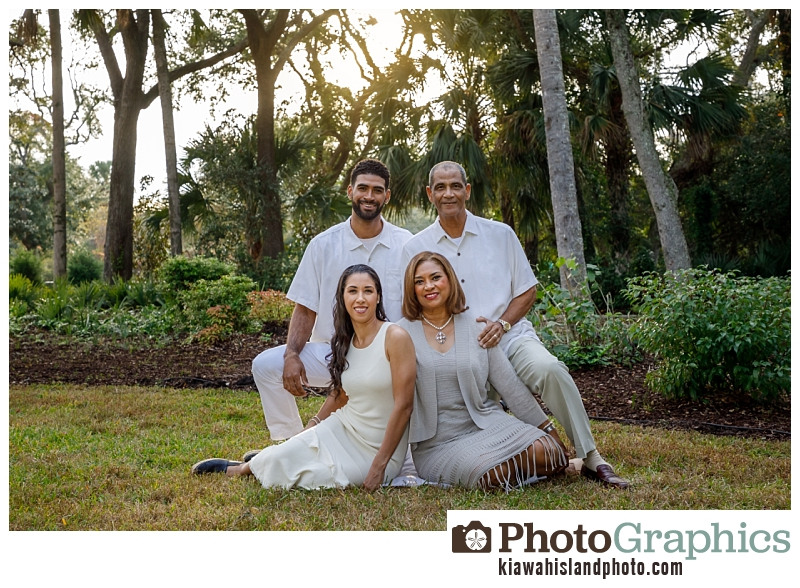 family sitting on the grass for family photos on Kiawah Island