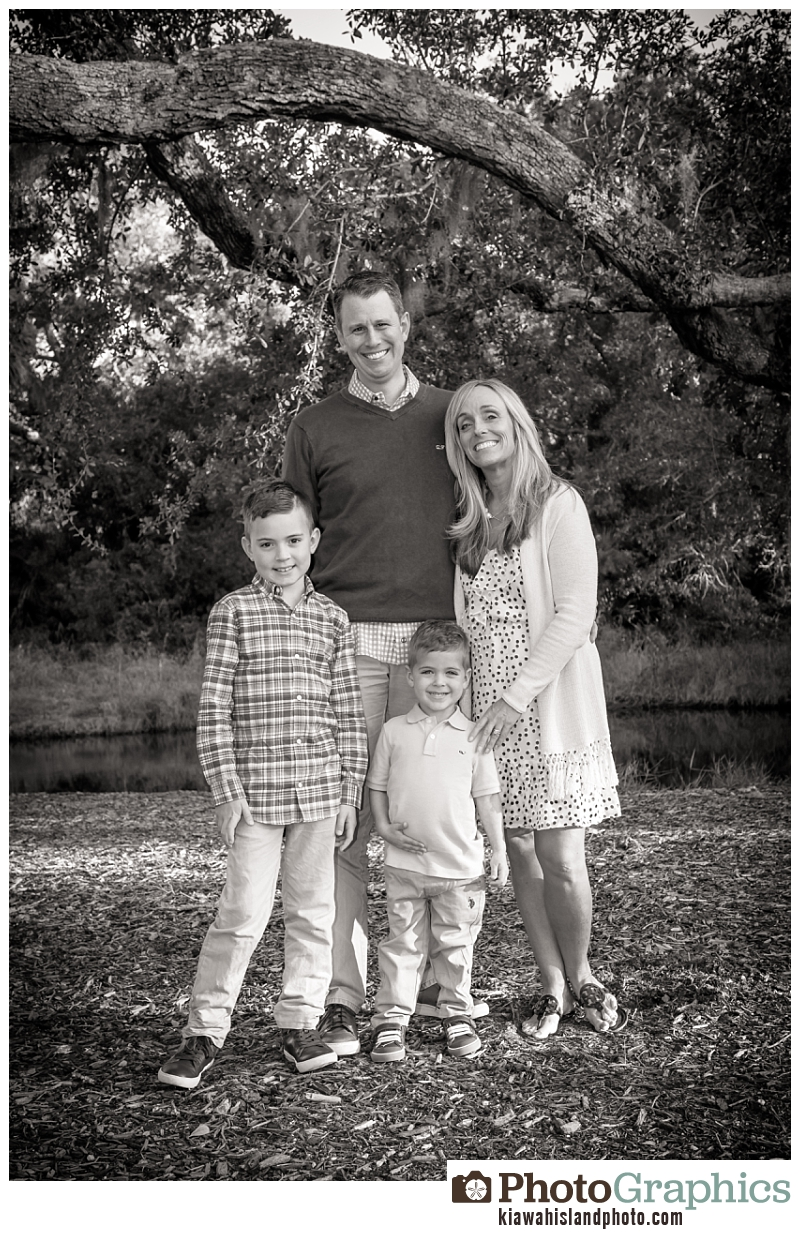 Family of four posing in grass, photo in black and white, kiawah island, kiawah island family photographer