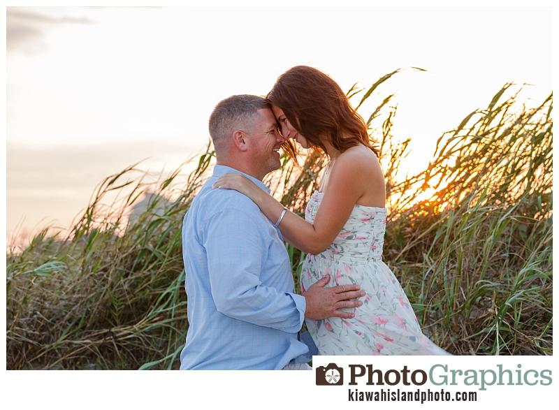 Couple on the beach for their baby bump photos